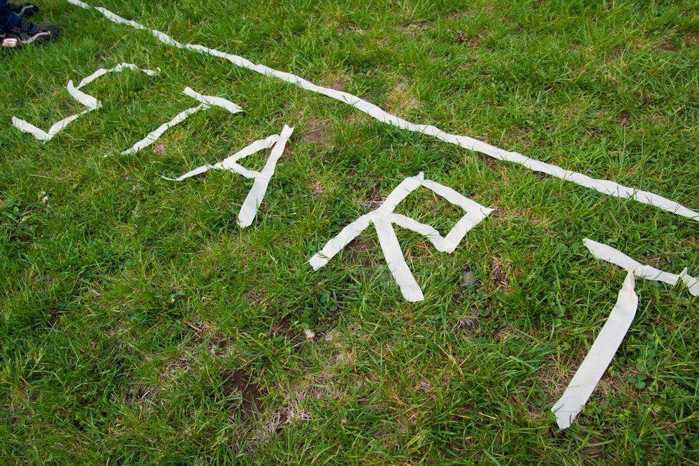 grass with a start line and the word start created from masking tape